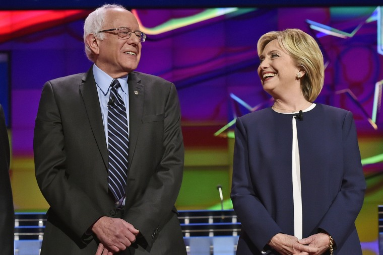 Democratic presidential candidates Sen. Bernie Sanders and Hillary Rodham Clinton talk before the CNN Democratic presidential debate on Oct. 13, 2015, in Las Vegas, Nev. (Photo by David Becker/AP)