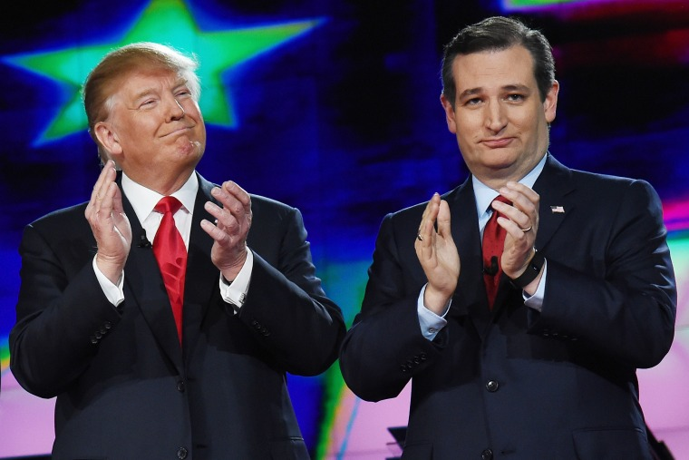 Republican presidential candidates Donald Trump and Sen. Ted Cruz applaud as they are introduced during the CNN presidential debate at The Venetian Las Vegas on Dec. 15, 2015 in Las Vegas, Nev. (Photo by Ethan Miller/Getty)
