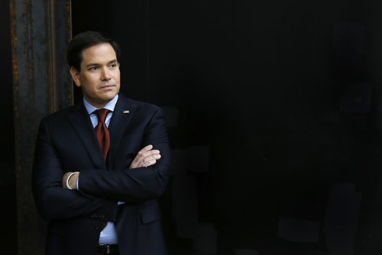 Republican presidential candidate Sen. Marco Rubio waits to speak at a caucus site on Feb. 1, 2016 in Clive, Iowa. (Photo by Paul Sancya/AP)