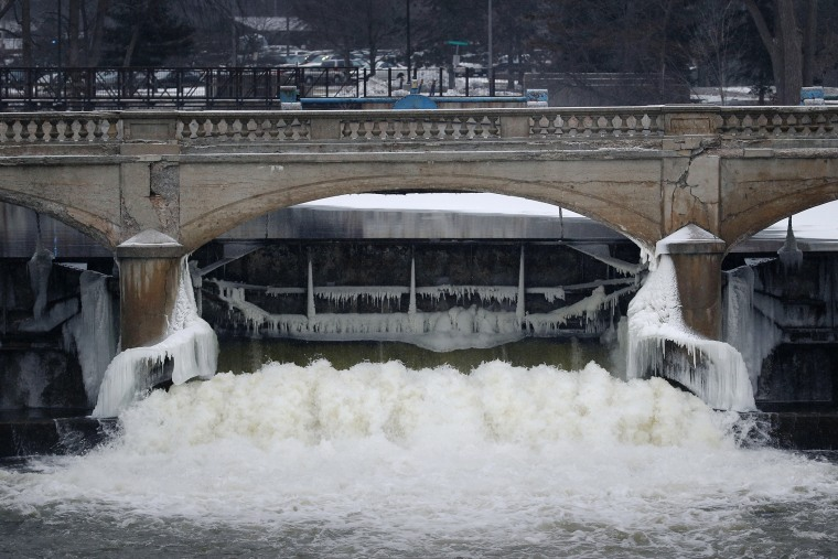 Water from the Flint River flows through the Hamilton Dam near downtown Flint, Mich., on Jan. 21, 2016. (Photo by Paul Sancya/AP)