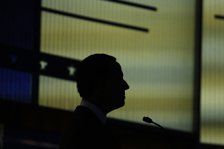 Republican presidential candidate and former Senator Rick Santorum is silhouetted against the backdrop during the undercard debate held by Fox News in Des Moines, Iowa, Jan. 28, 2016. (Photo by Carlos Barria/Reuters)