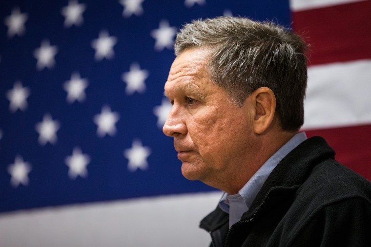 Republican presidential candidate Ohio Governor John Kasich speaks at a town hall meeting on Feb. 3, 2016 in Raymond, N.H. (Photo by Andrew Burton/Getty)