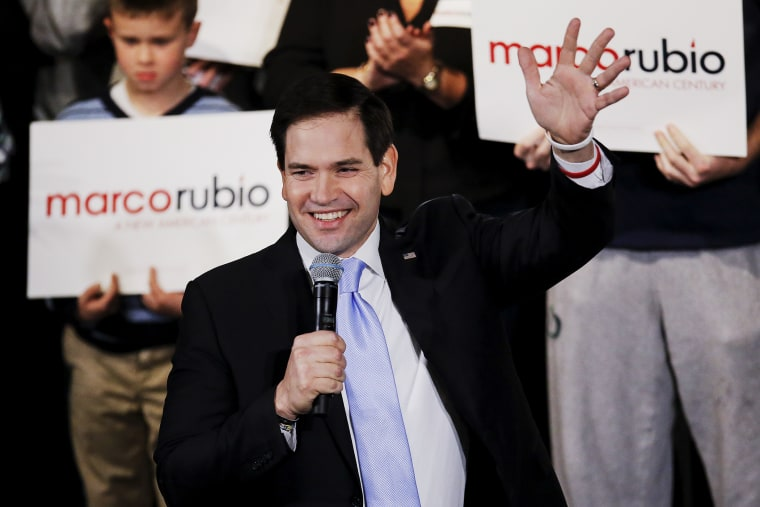 Senator and Republican presidential candidate Marco Rubio waves as he arrives at a campaign rally in Exeter, N.H., Feb. 2, 2016. (Photo by Carlo Allegri/Reuters)