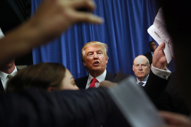 Republican Presidential candidate Donald Trump greets people in an overflow room during a campaign event at Hampshire Hills Athletic Club on Feb. 2, 2016 in Milford, Iowa. (Photo by Joe Raedle/Getty)