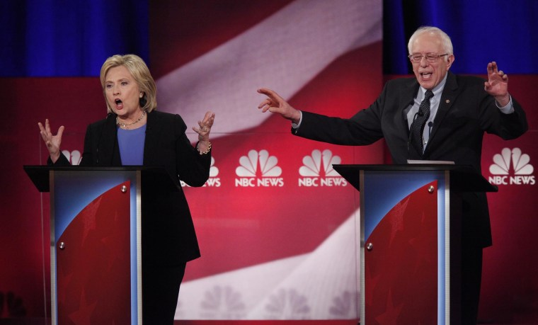 Democratic U.S. presidential candidates Hillary Clinton and Senator Bernie Sanders speak simultaneously at the NBC News - YouTube Democratic presidential candidates debate in Charleston, S.C., Jan. 17, 2016. (Photo by Randall Hill/Reuters)