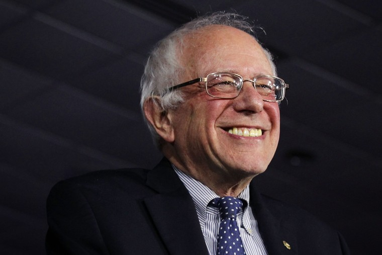 Democratic presidential candidate Sen. Bernie Sanders (I-VT) smiles as he speaks to supporters during a caucus night party Feb. 1, 2016 in Des Moines, Iowa. (Photo by Alex Wong/Getty)