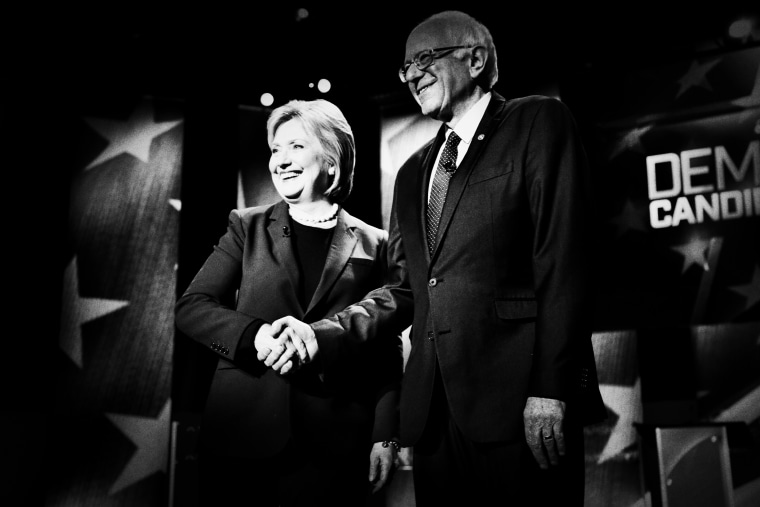 Democratic presidential candidates Hillary Clinton and Sen. Bernie Sanders greet the audience before the Democratic presidential primary debate hosted by MSNBC at the University of New Hampshire on Feb. 4, 2016, in Durham, N.H.