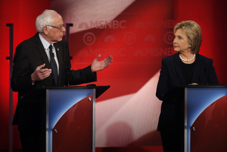 Bernie Sanders speaks as Hillary Clinton looks on as they discuss issues during the MSNBC Democratic debate at the University of New Hampshire in Durham, N.H., Feb. 4, 2016. (Photo by Mike Segar/Reuters)