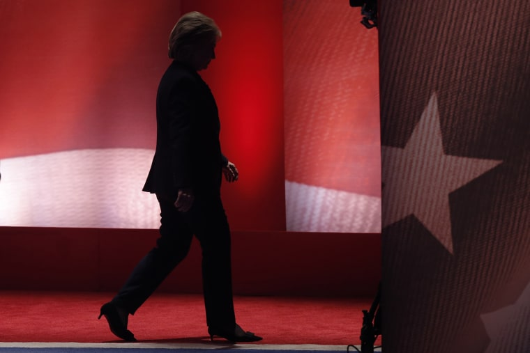 Hillary Clinton walks offstage during a break after a fiery exchange with rival candidate Bernie Sanders during the MSNBC Democratic debate in Durham, N.H., Feb. 4, 2016. (Photo by Mike Segar/Reuters)