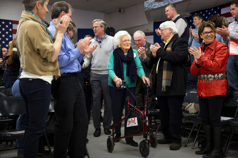 People stand and applaud as Republican presidential candidate and former Florida Gov. Jeb Bush arrives with his mother Barbara Bush to a town hall meeting in Derry, N.H., Feb. 4, 2016. (Photo by Jacquelyn Martin/AP)