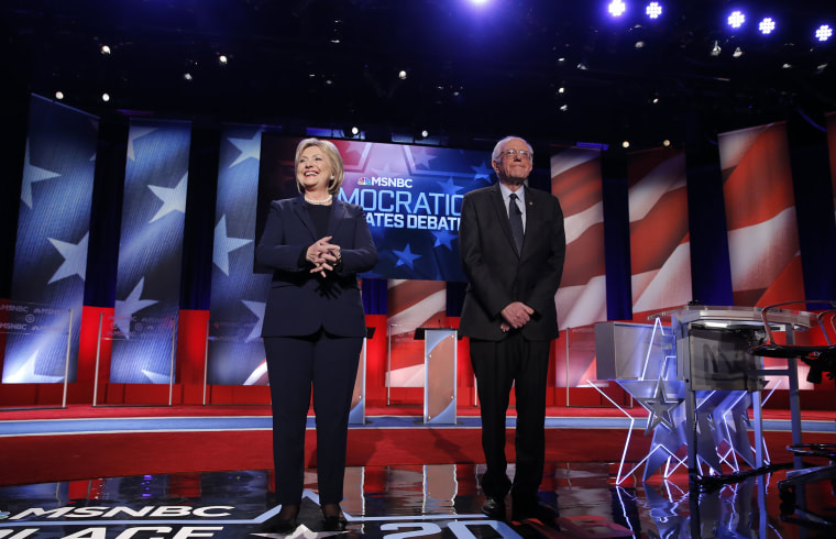 Democratic presidential candidates Hillary Clinton and Bernie Sanders on stage before the start of the Democratic presidential debate sponsored by MSNBC at the University of New Hampshire in Durham, N.H., Feb. 4, 2016. (Photo by Carlo Allegri/Reuters)