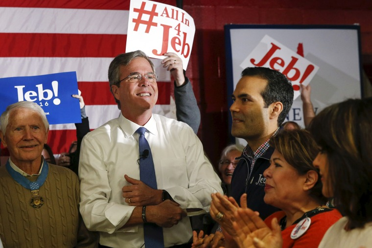 Republican U.S. presidential candidate Jeb Bush stands near his son George P. Bush and wife Columba before addressing a town hall during a campaign stop at Woodbury School in Salem, N.H., Feb. 7, 2016. (Photo by Adrees Latif/Reuters)