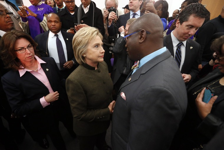 Democratic presidential candidate Hillary Clinton speaks with an audience member at the House Of Prayer Missionary Baptist Church, Feb. 7, 2016 in Flint, Mich. (Photo by Paul Sancya/AP)