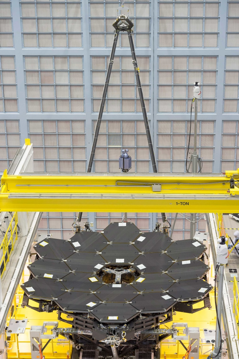 In this rare view, the James Webb Space Telescope's 18 mirrors are seen fully installed on the James Webb Space Telescope structure at NASA's Goddard Space Flight Center in Greenbelt, Maryland.