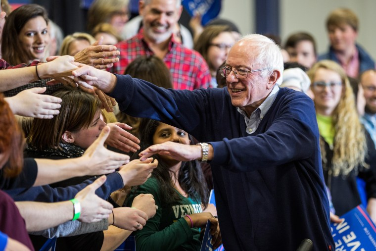 Democratic presidential candidate Sen. Bernie Sanders (D-VT) shakes hands with supporters at a campaign rally at Great Bay Community College on Feb. 7, 2016 in Portsmouth, N.H. (Photo by Andrew Burton/Getty)