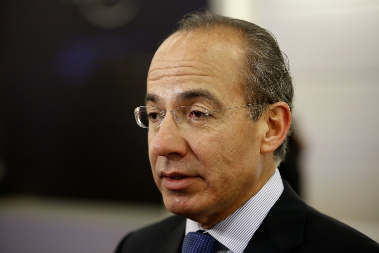 Felipe Calderon, former president of Mexico, speaks to an attendee in the halls on the opening day of the World Economic Forum (WEF) in Davos, Switzerland, Jan. 23, 2013. (Photo by Jason Alden/Bloomberg/Getty)