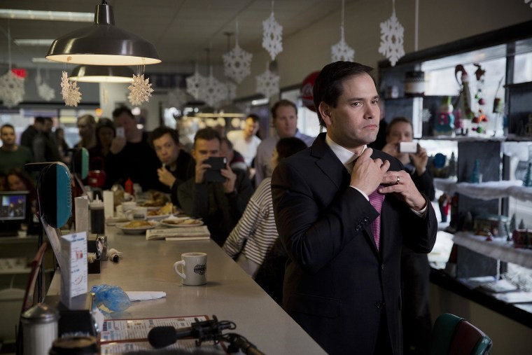 Senator Marco Rubio, a Republican from Florida and 2016 presidential candidate, adjusts his tie before an interview during a campaign stop at Norton's Cafe in Nashua, N.H., U.S., Feb. 8, 2016. (Photo by Victor J. Blue/Bloomberg/Getty)