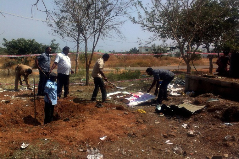 Indian authorities inspect the site of a suspected meteorite landing on Feb. 7, 2016 in Vellore district in southern Tamil Nadu state. The impact of the meteorite killed a bus driver and injured three others on Feb. 6. (Photo by STR/AFP/Getty)