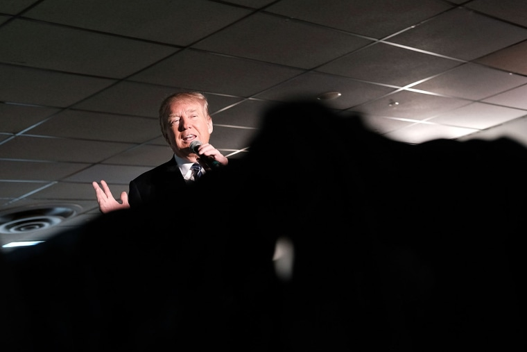 Republican presidential candidate Donald Trump speaks to a small crowd a day before voters go to the polls on Feb. 8, 2016 in Salem, N.H. (Photo by Spencer Platt/Getty)