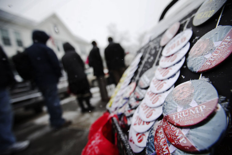 Snow collects on buttons for sale outside a campaign event for Republican presidential candidate Donald Trump at the Londonderry Lions Club, Feb. 8, 2016, in Londonderry, N.H. (Photo by David Goldman/AP)