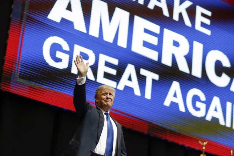 Republican presidential candidate, businessman Donald Trump waves has he arrives for a campaign rally, Feb. 8, 2016, in Manchester, N.H. (Photo by David Goldman/AP)