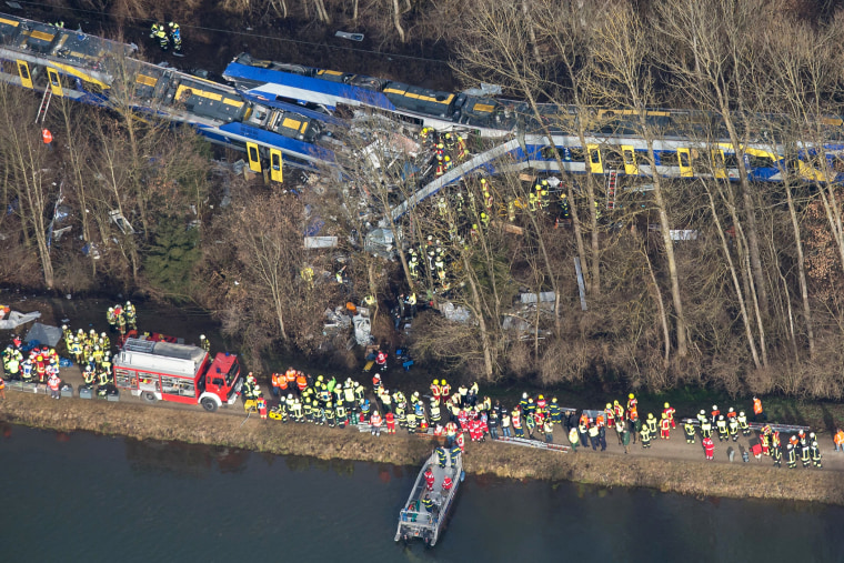 Firefighters and emergency doctors work at the site of a train accident near Bad Aibling, southern Germany, on Feb. 9, 2016. (Photo by Peter Kneffel/AFP/Getty)