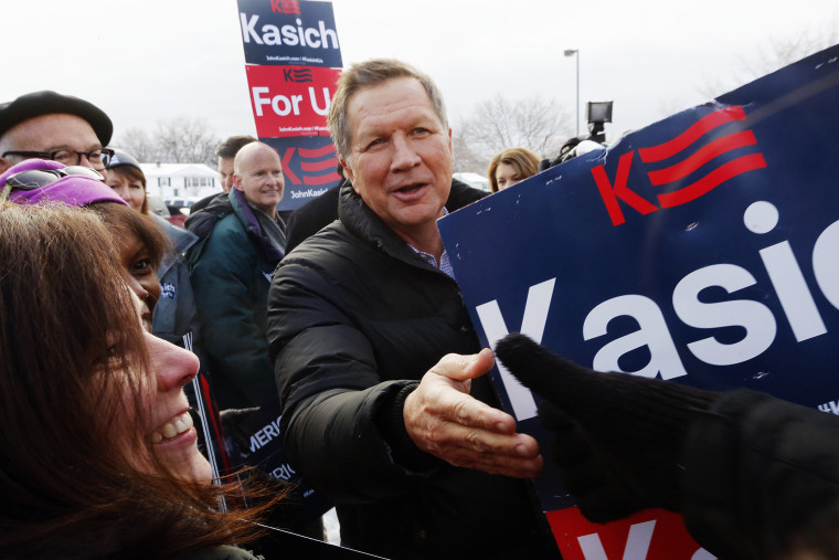 Republican presidential candidate, Ohio Gov. John Kasich greets supporters at a polling station at the high school, Feb. 9, 2016, in Manchester, N.H. (Photo by Jim Cole/AP)