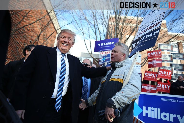Republican presidential candidate Donald Trump greets people as he visits a polling station as voters cast their primary day ballots on Feb. 9, 2016 in Manchester, N.H. (Photo by Joe Raedle/Getty)