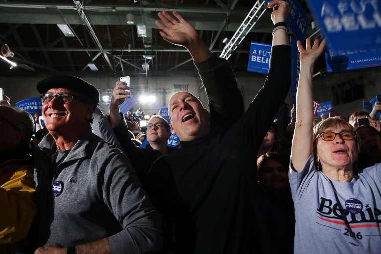 People cheer as Sen. Bernie Sanders (D-VT) speaks onstage after victory over Hillary Clinton in the New Hampshire primary on Feb. 9, 2016 in Concord, N.H. (Photo by Spencer Platt/Getty)
