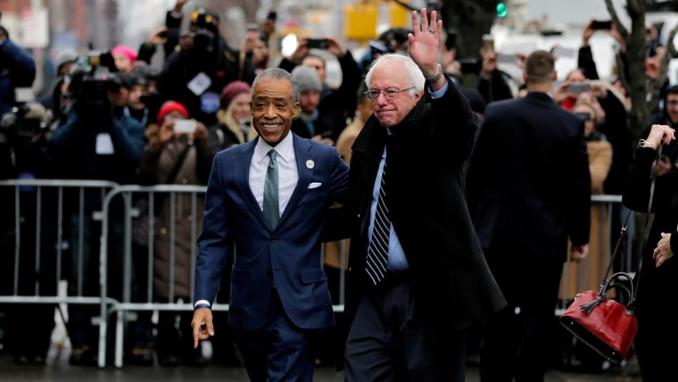 Senator from Vermont and Democratic presidential hopeful Bernie Sanders (R) arrives at Sylvia's restaurant in Harlem and is greeted by Reverend Al Sharpton in New York, N.Y., on Feb. 10, 2016. (Photo by Peter Foley/EPA)