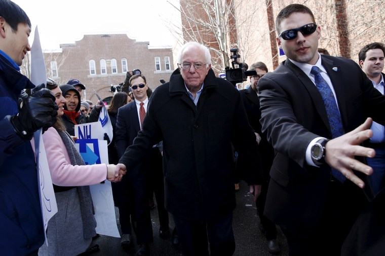 Bernie Sanders shakes hands with voters outside a polling place in Concord, N.H., Feb. 9, 2016. (Photo by Shannon Stapleton/Reuters)