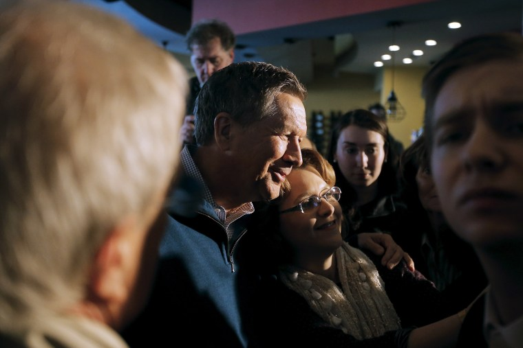 John Kasich poses for a picture with a supporter during a campaign event in Mount Pleasant, S.C., Feb. 10, 2016. (Photo by Chris Keane/Reuters)