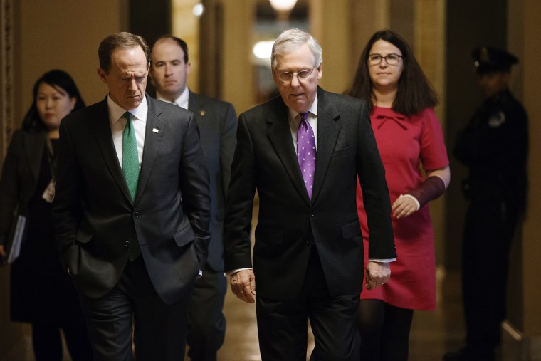 Senate Majority Leader Mitch McConnell, R-Ky., walks with Sen. Pat Toomey, R-Pa. to the chamber to vote at the Capitol in Washington, Feb. 10, 2016. (Photo by J. Scott Applewhite/AP)