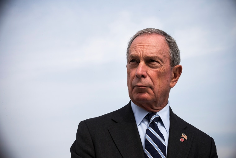 Then, New York City Mayor Michael Bloomberg speaks at a press conference on Aug. 19, 2013 in the Greenpoint neighborhood of the Brooklyn Borough of New York, N.Y. (Photo by Andrew Burton/Getty)