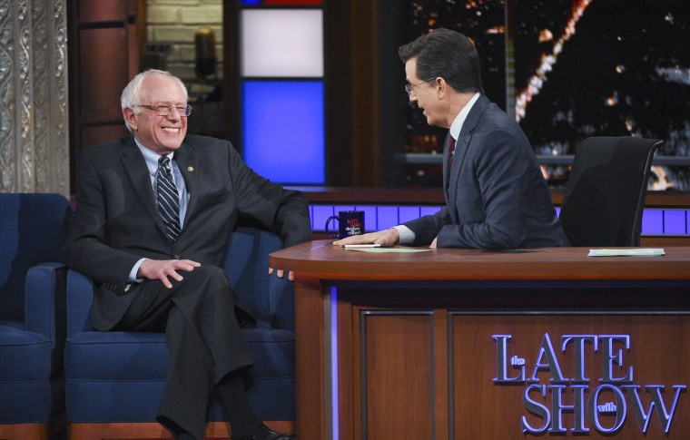 """This image released by CBS shows Democratic presidential candidate Sen. Bernie Sanders, of Vermont, with host Stephen Colbert during a taping of """"The Late Show with Stephen Colbert,"""" Feb. 10, 2016, in New York. (Photo by Jeffrey R. Staab/CBS/AP)"""