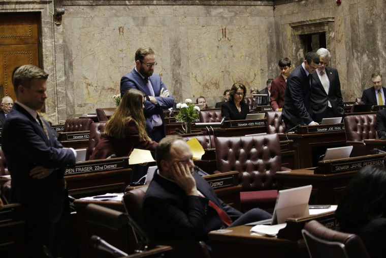 Senators watch the vote count on their computers on a bill barring transgender people to use gender-consistent bathrooms and locker rooms in public buildings, Feb. 10, 2016, in Olympia, Wash. (Photo by Rachel La Corte/AP)