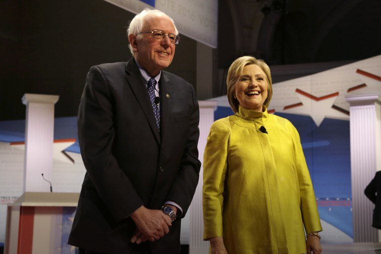Democratic presidential candidates Sen. Bernie Sanders and Hillary Clinton smile as they take the stage before a Democratic debate, Feb. 11, 2016, in Milwaukee, Wis. (Photo by Tom Lynn/AP)