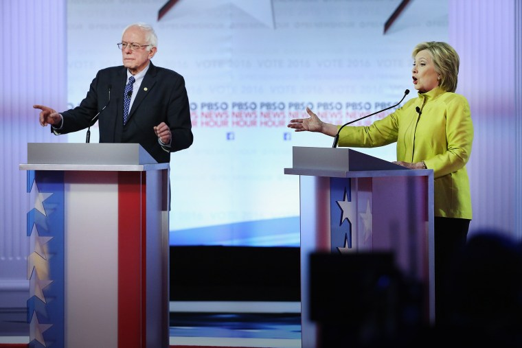 Democratic presidential candidates Senator Bernie Sanders and Hillary Clinton argue during the PBS NewsHour debate on Feb. 11, 2016 in Milwaukee, Wis. (Photo by Win McNamee/Getty)