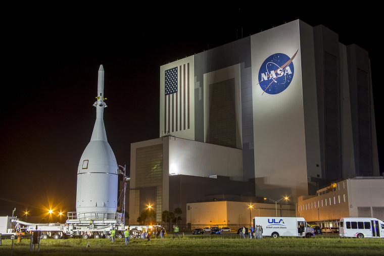 The Orion capsule is moved at Kennedy Space Center in Florida, Nov. 11, 2014. The NASA spacecraft was designed to one day fly astronauts to Mars. (Photo by Mike Brown/Reuters)