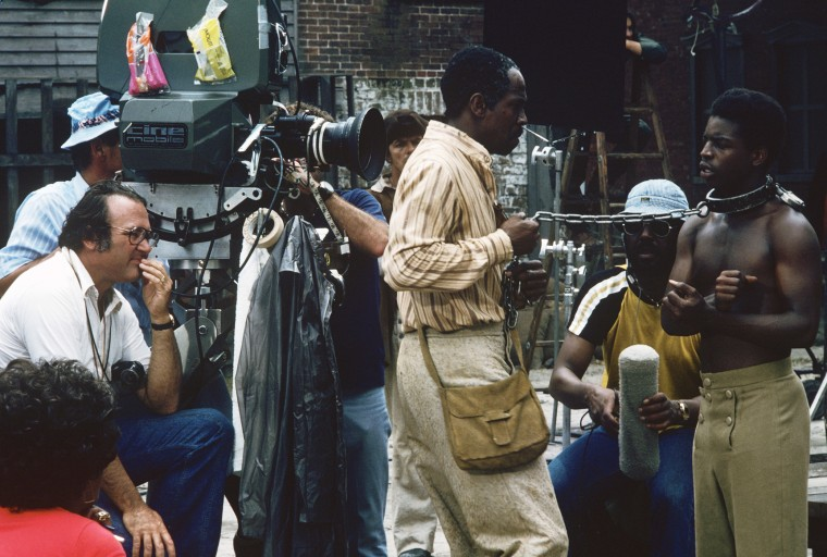 Behind the scenes image of Lou Gossett Jr. and Levar Burton shooting ROOTS, Jan. 23, 1977. (Photo handout by ABC)