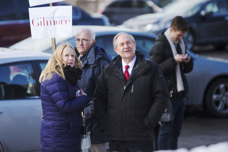 Republican presidential candidate Jim Gilmore greets voters outside the polling place at Webster School on primary day Feb. 9, 2016 in Manchester, N.H. (Photo by Scott Eisen/Getty)