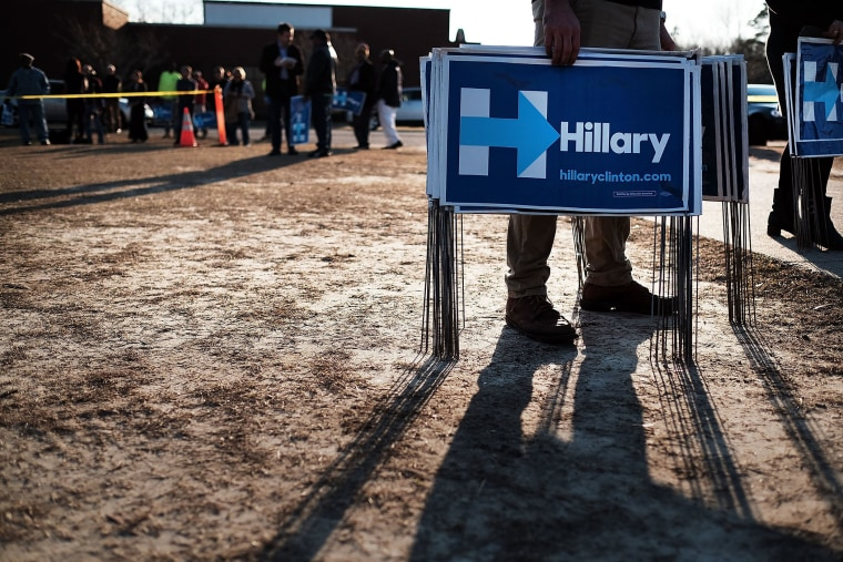 Campaign workers try to pass out signs following an appearance by Democratic presidential candidate Hillary Clinton on Feb. 12, 2016 in Denmark, S.C. (Photo by Spencer Platt/Getty)