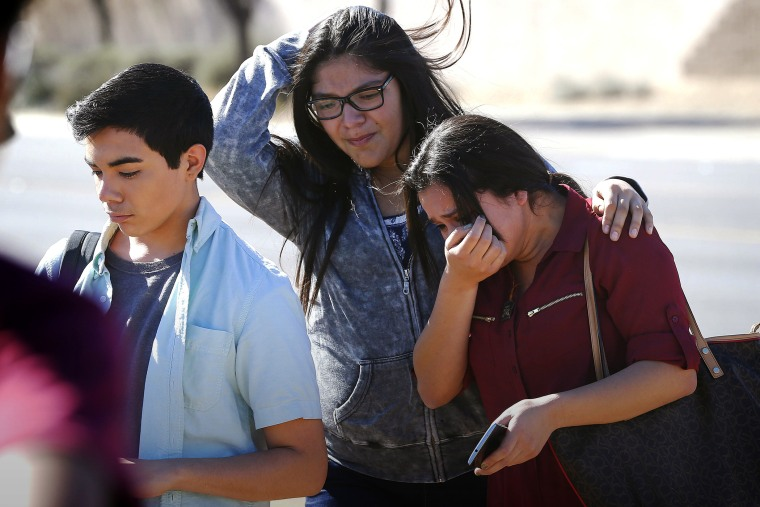 Students walk to their parents after being released from lockdown, Feb. 12, 2016, in Glendale, Ariz., after two students were shot and killed at Independence High School. (Photo by Matt York/AP)