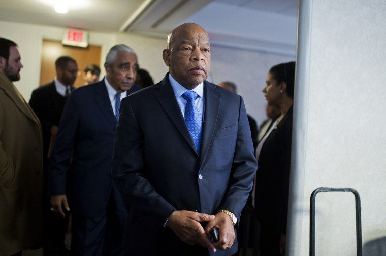 Rep. John Lewis and Rep. Charlie Rangel arrive for a news conference at the DNC where members of the Congressional Black Caucus PAC endorsed Hillary Clinton for president, Feb. 11, 2016. (Photo By Tom Williams/CQ Roll Call/Getty)