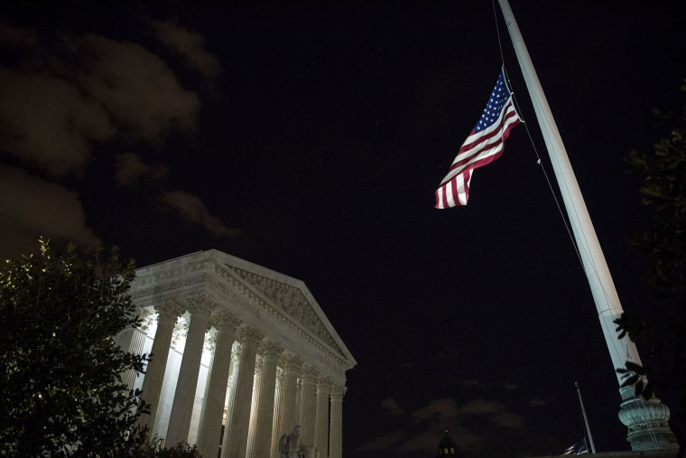 The American flag flies at half mast at the U.S. Supreme Court, Feb. 13, 2016 in Washington, DC. Supreme Court Justice Antonin Scalia was at a Texas Ranch Saturday morning when he died at the age of 79. (Photo by Drew Angerer/Getty)