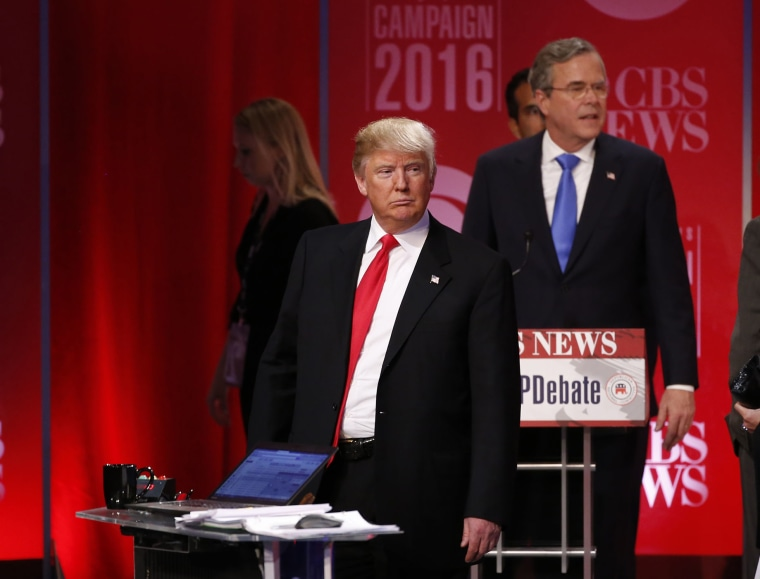 Republican U.S. presidential candidate former Governor Jeb Bush walks past rival candidate businessman Donald Trump as he stands at the front of the stage at the conclusion of the debate, Feb. 13, 2016. (Photo by Jonathan Ernst/Reuters)