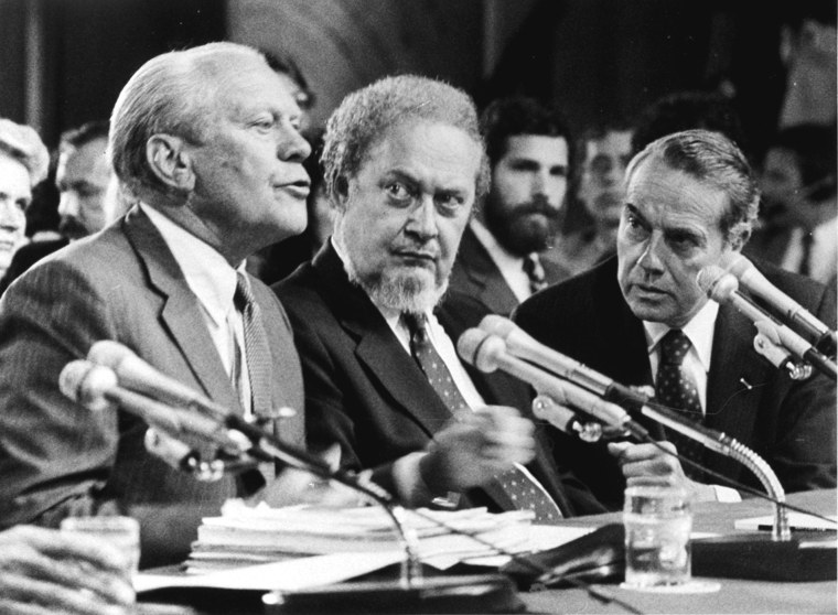In this Sep. 15, 1987 photo, former President Gerald Ford, left, introduces Supreme Court Associate Justice nominee Robert Bork, as the Senate Judiciary Committee began confirmation hearings on the nomination on Capitol Hill. (Photo by Charles Tasnadi/AP)