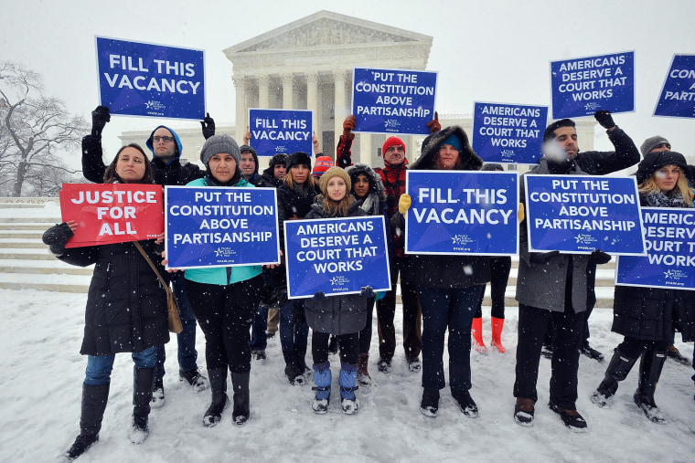 People For the American Way activists rally outside of the Supreme Court on Feb. 15, 2016 in Washington DC. (Photo by Larry French/People for the American Way/Getty)