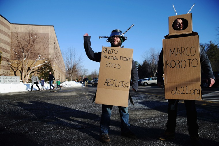 Workers from the American Bridge 21st Century super PAC wear robot costumes outside a Sen. Marco Rubio (R-FL) town hall in Londonderry, N.H., Feb. 7, 2016. (Photo by Chip Somodevilla/Getty)