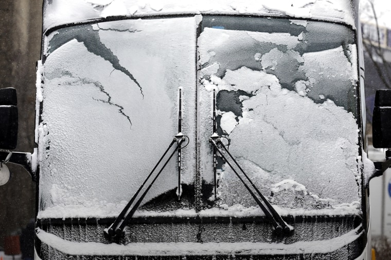 A bus window is covered by snow and ice, Feb. 14, 2016, in Evanston, Ill. (Photo by Nam Y. Huh/AP)